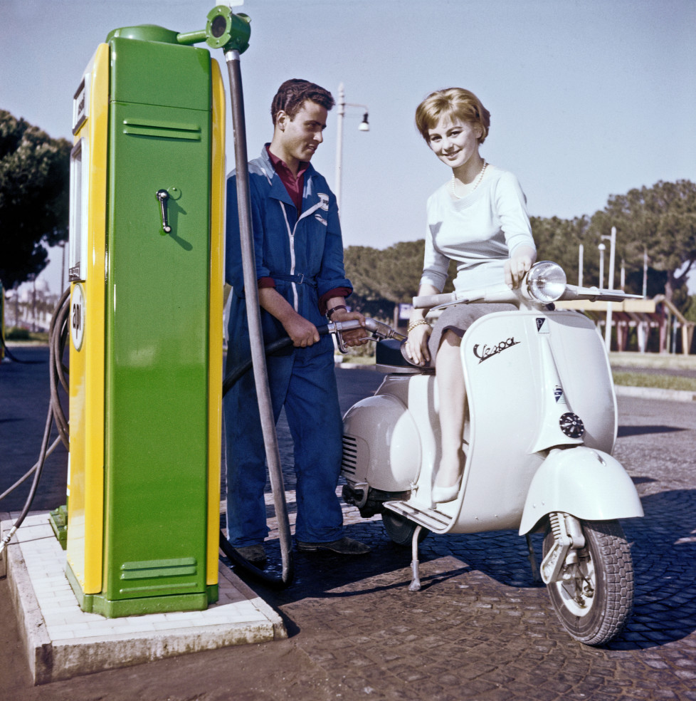 Italian actress Alessandra Panaro refueling her Vespa at a gas station on the road. Rome, 1957 (Photo by Pierluigi PraturlonReporters Associati & ArchiviMondadori Portfolio via Getty Images)