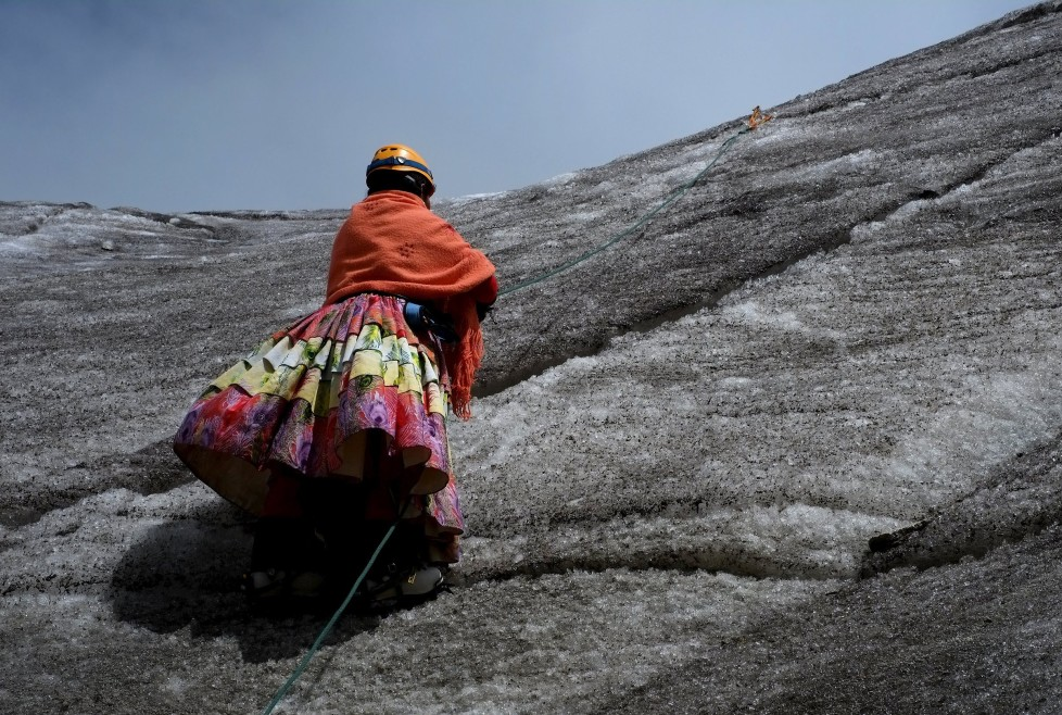 "An Aymara indigenous woman practises climbing on the Huayna Potosi mountain, Bolivia April 6, 2016. Two years ago, about a dozen Aymara indigenous women, aged 42 to 50, who worked as porters and cooks for mountaineers at base camps and mountain climbing refuges on the steep, glacial slopes of Huayna Potosi, an Andean peak outside La Paz, Bolivia, put on crampons under their wide traditional skirts and started to do their own climbing. REUTERS/David Mercado SEARCH ""CHOLITA CLIMBERS"" FOR THIS STORY. SEARCH ""THE WIDER IMAGE"" FOR ALL STORIES TPX IMAGES OF THE DAY"