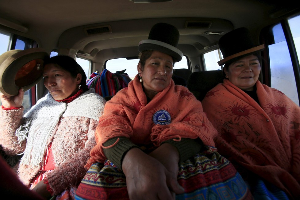 "Aymara indigenous women Bertha Vedia (L), Dora Magueno (C) and Lidia Huayllas sit in a car in El Alto, Bolivia, April 6, 2016. Two years ago, about a dozen Aymara indigenous women, aged 42 to 50, who worked as porters and cooks for mountaineers at base camps and mountain climbing refuges on the steep, glacial slopes of Huayna Potosi, an Andean peak outside La Paz, Bolivia, put on crampons under their wide traditional skirts and started to do their own climbing. REUTERS/David Mercado SEARCH ""CHOLITA CLIMBERS"" FOR THIS STORY. SEARCH ""THE WIDER IMAGE"" FOR ALL STORIES"