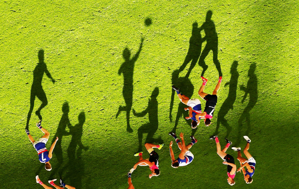 MELBOURNE, AUSTRALIA - MAY 15: (EDITORS NOTE: This image was rotated from its original perspective.) Long shadows are cast by players as Mitch Wallis of the Bulldogs passes the ball during the 2016 AFL Round 08 match between the Melbourne Demons and the Western Bulldogs at the Melbourne Cricket Ground, Melbourne on May 15, 2016. (Photo by Scott Barbour/AFL Media/Getty Images)
