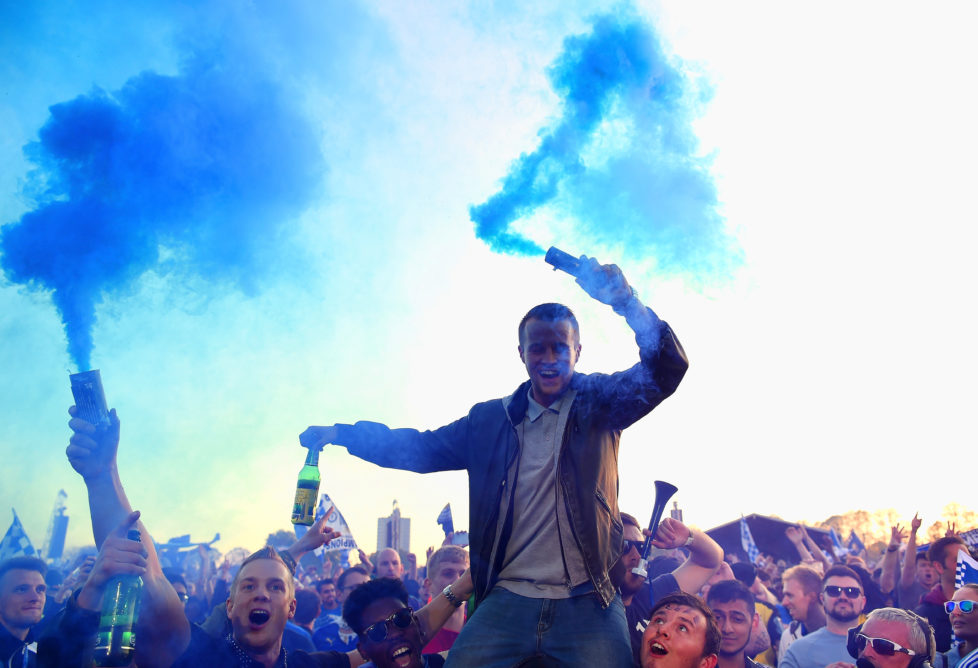 LEICESTER, ENGLAND - MAY 16: Fans celebrate as Kasabian play a live set during the Leicester City Barclays Premier League winners bus parade on May 16, 2016 in Leicester, England. (Photo by Laurence Griffiths/Getty Images)