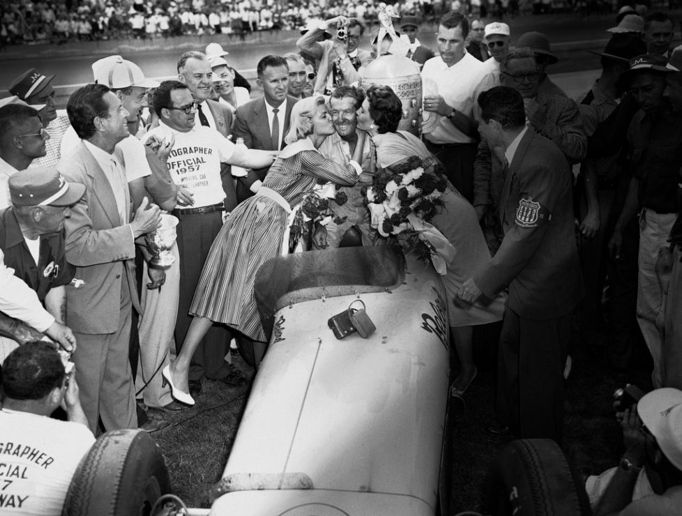 FILE - In this May 30, 1957, file photo, Sam Hanks is kissed by his wife, Alice, left, and movie actress Cyd Charisse, after winning the Indianapolis 500 auto race in Indianapolis, Ind. (AP Photo.File)