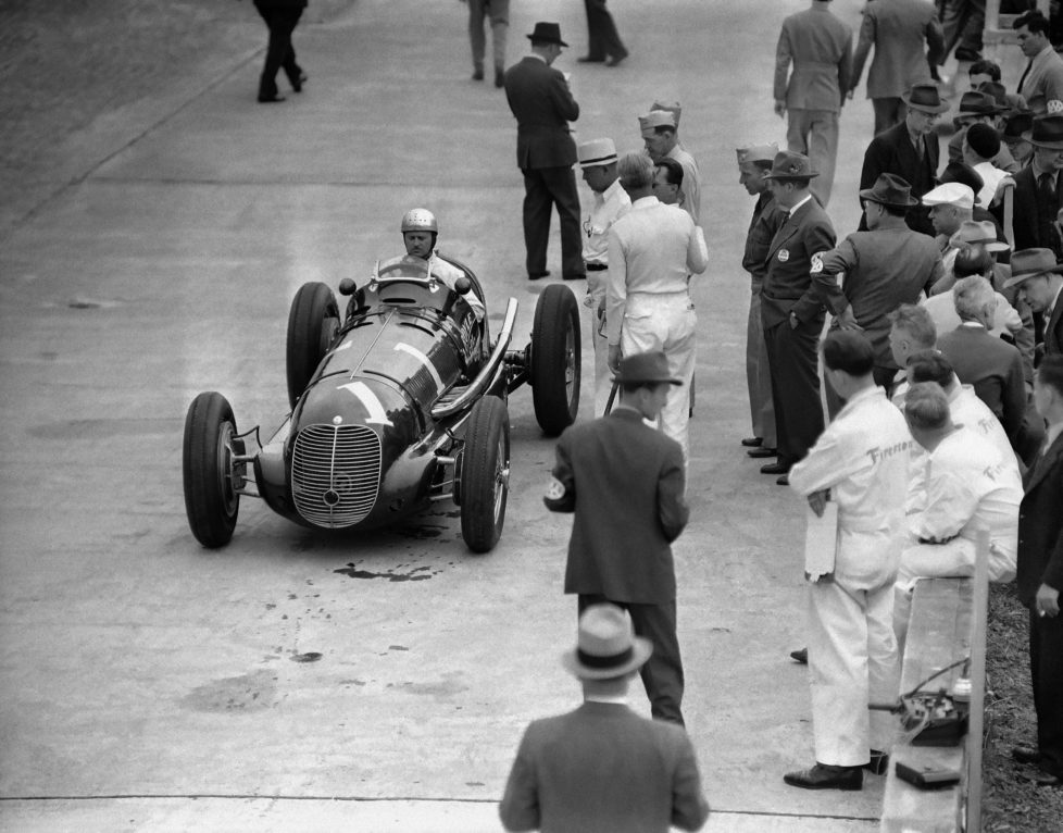 Wilbur Shaw of Indianapolis, 500-mile Speed race winner in 1937 and 1939, after he qualified for the Memorial Day race at Indianapolis, Indiana on May 18, 1940. (AP Photo/Weston Haynes)