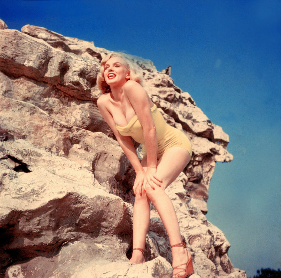 UNITED STATES - JANUARY 01: Portrait, around 1960, of Marilyn MONROE posing in a bathing suit on a rock. (Photo by Keystone-France/Gamma-Keystone via Getty Images)