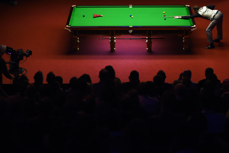 England's Mark Selby plays a shot during the third session of the World Snooker Championship final against China's Ding Junhui at the Crucible theatre, in Sheffield, northern England on May 2, 2016. / AFP PHOTO / PAUL ELLIS