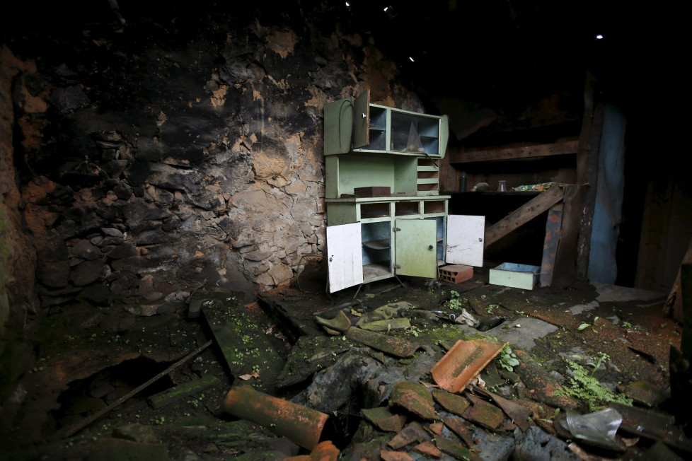 """The interior of an abandoned house is seen in Agracoes, near Chaves, Portugal April 18, 2016. In the villages of Agracoes and Povoa de Agracoe the steady drip-drip of emigration has brought down population numbers from more than 50 residents to fewer than a dozen each. These remaining villagers share the same glum acceptance that, after they have gone, their villages will die out too. It is the same desolate picture in scores of other backwater settlements in Portugal's interior, north to south. REUTERS/Rafael Marchante SEARCH """"ABANDONED PORTUGAL"""" FOR THIS STORY. SEARCH """"THE WIDER IMAGE"""" FOR ALL STORIES TPX IMAGES OF THE DAY"""