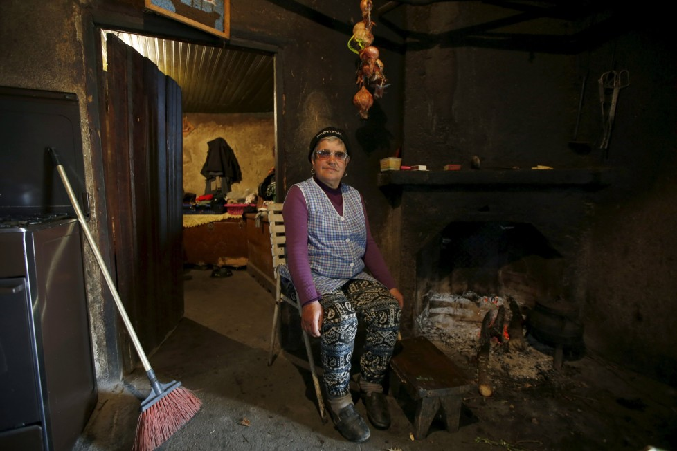 """Maria Fontes poses for a portrait inside her house in Agracoes, near Chaves, Portugal April 18, 2016. In the villages of Agracoes and Povoa de Agracoe the steady drip-drip of emigration has brought down population numbers from more than 50 residents to fewer than a dozen each. These remaining villagers share the same glum acceptance that, after they have gone, their villages will die out too. It is the same desolate picture in scores of other backwater settlements in Portugal's interior, north to south. REUTERS/Rafael Marchante SEARCH """"ABANDONED PORTUGAL"""" FOR THIS STORY. SEARCH """"THE WIDER IMAGE"""" FOR ALL STORIES"""