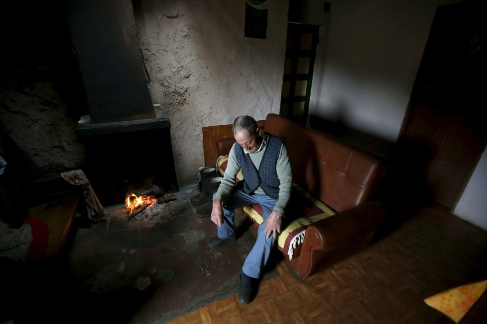 """Fernando rests on a sofa inside his house in Povoa de Agracoes, near Chaves, Portugal April 19, 2016. In the villages of Agracoes and Povoa de Agracoe the steady drip-drip of emigration has brought down population numbers from more than 50 residents to fewer than a dozen each. These remaining villagers share the same glum acceptance that, after they have gone, their villages will die out too. It is the same desolate picture in scores of other backwater settlements in Portugal's interior, north to south. REUTERS/Rafael Marchante SEARCH """"ABANDONED PORTUGAL"""" FOR THIS STORY. SEARCH """"THE WIDER IMAGE"""" FOR ALL STORIES"""