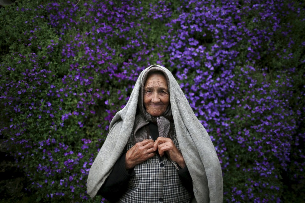 """Zulmira Jesus poses for a portrait at a street in Povoa de Agracoes, near Chaves, Portugal April 19, 2016. In the villages of Agracoes and Povoa de Agracoe the steady drip-drip of emigration has brought down population numbers from more than 50 residents to fewer than a dozen each. These remaining villagers share the same glum acceptance that, after they have gone, their villages will die out too. It is the same desolate picture in scores of other backwater settlements in Portugal's interior, north to south. REUTERS/Rafael Marchante SEARCH """"ABANDONED PORTUGAL"""" FOR THIS STORY. SEARCH """"THE WIDER IMAGE"""" FOR ALL STORIES TPX IMAGES OF THE DAY"""