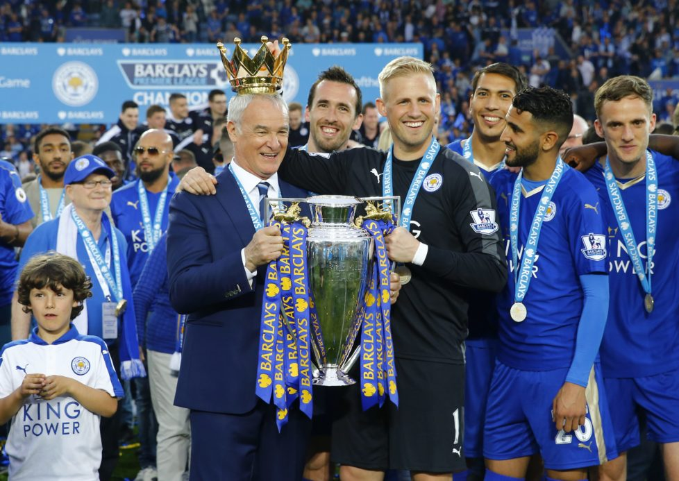 "Britain Soccer Football - Leicester City v Everton - Barclays Premier League - King Power Stadium - 7/5/16 Leicester City manager Claudio Ranieri holds the trophy as he celebrates winning the Barclays Premier League with Kasper Schmeichel and teammates Reuters / Darren Staples Livepic EDITORIAL USE ONLY. No use with unauthorized audio, video, data, fixture lists, club/league logos or ""live"" services. Online in-match use limited to 45 images, no video emulation. No use in betting, games or single club/league/player publications. Please contact your account representative for further details."