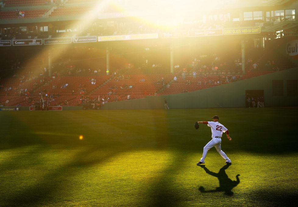 BOSTON, MA - MAY 11: Rick Porcello #22 of the Boston Red Sox warms up in center field before the game against the Oakland Athletics at Fenway Park on May 11, 2016 in Boston, Massachusetts. (Photo by Adam Glanzman/Getty Images) *** BESTPIX ***