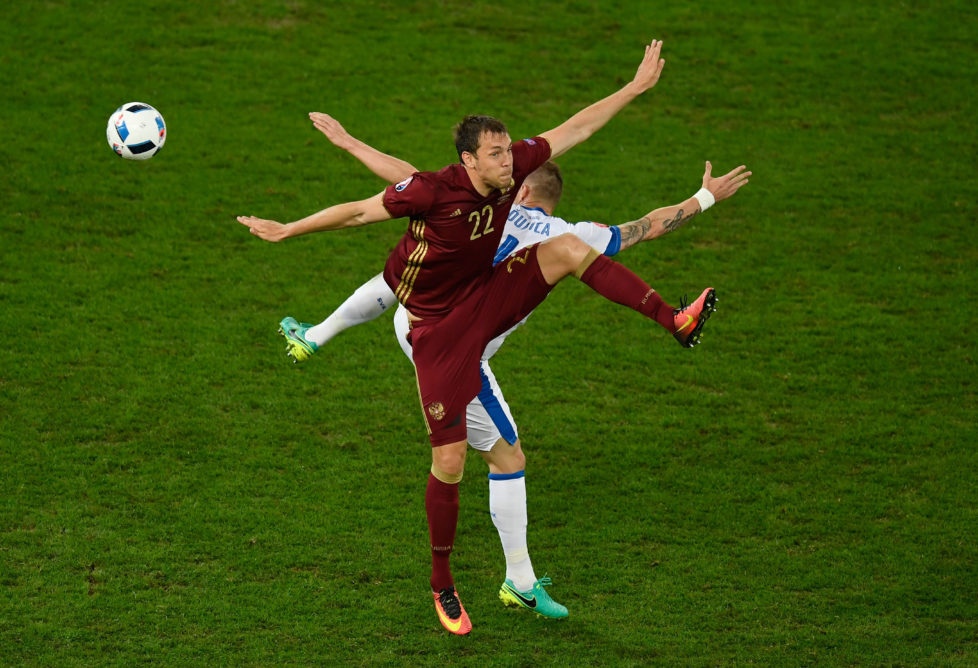 LILLE, FRANCE - JUNE 15: Jan Durica of Slovakia and Artem Dzyuba of Russia batlle for possesion during the UEFA EURO 2016 Group B match between Russia and Slovakia at Stade Pierre-Mauroy on June 15, 2016 in Lille, France. (Photo by Mike Hewitt/Getty Images)