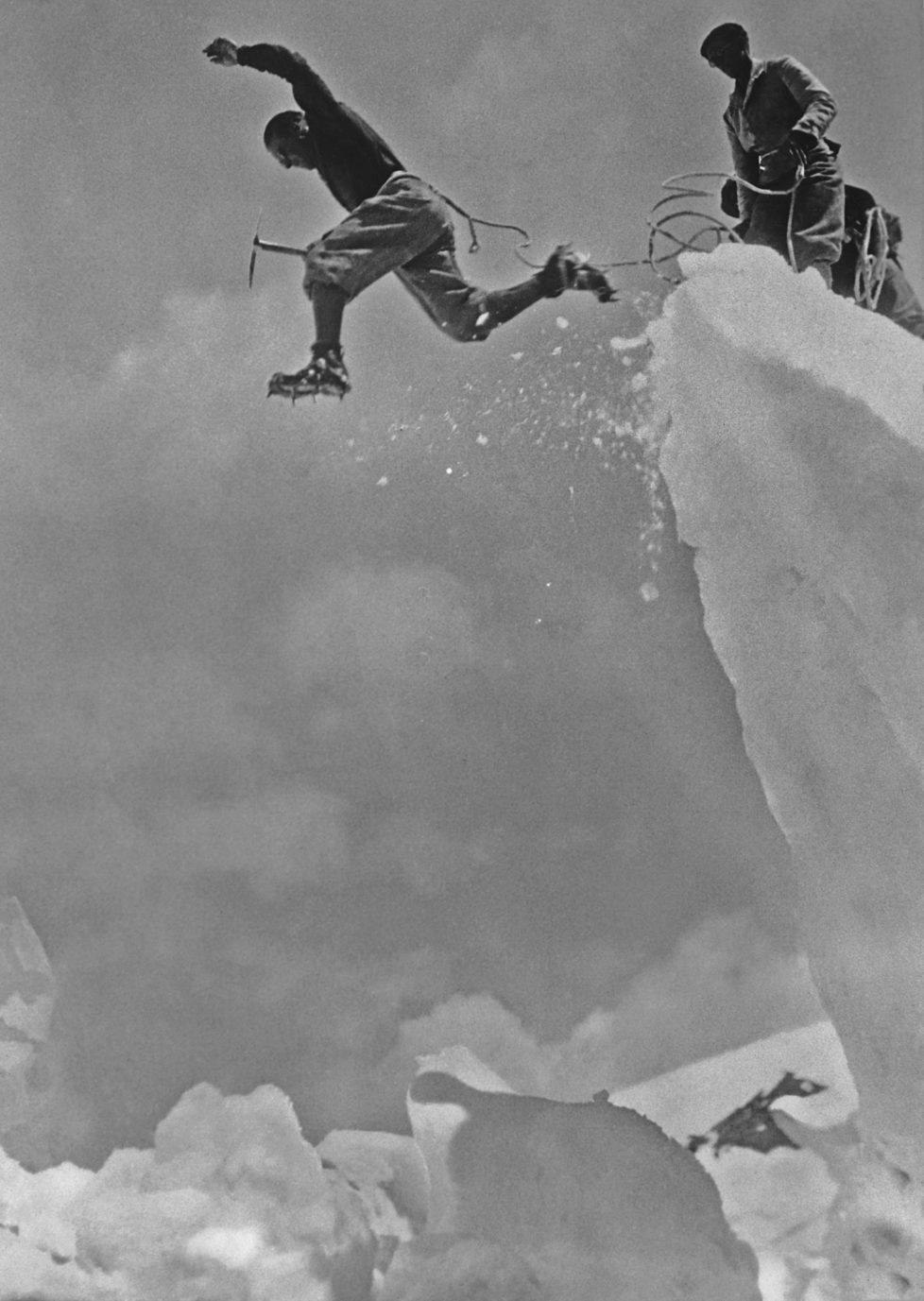 A Swiss mountaineer leaps over a crevasse in the Swiss Alps, 5th December 1930. (Photo by Henry Miller News Picture Service/Archive Photos/Getty Images)