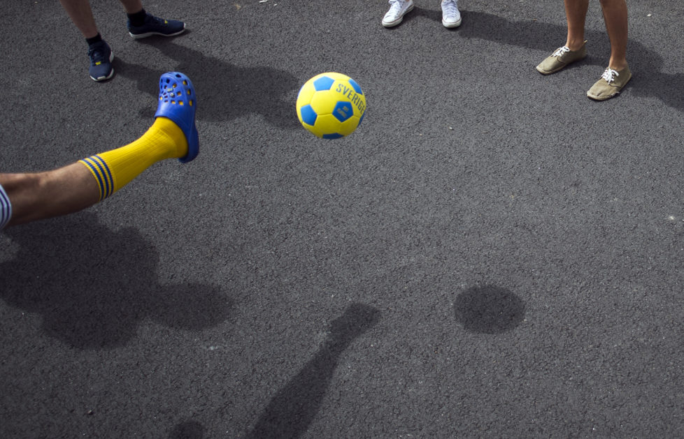 Sweden supporters play football outside a closed training session at Sweden's training ground in Saint-Nazaire on June 15, 2016 during the Euro 2016 football tournament. / AFP PHOTO / JONATHAN NACKSTRAND
