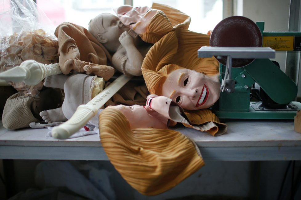"""Masks, including some of U.S. Democratic presidential candidate Hillary Clinton, are seen at Jinhua Partytime Latex Art and Crafts Factory in Jinhua, Zhejiang Province, China, May 25, 2016. There's no masking the facts. One Chinese factory is expecting Donald Trump to beat his likely U.S. presidential rival Hilary Clinton in the popularity stakes. At the Jinhua Partytime Latex Art and Crafts Factory, a Halloween and party supply business that produces thousands of rubber and plastic masks of everyone from Osama Bin Laden to Spiderman, masks of Donald Trump and Democratic frontrunner Hillary Clinton faces are being churned out. Sales of the two expected presidential candidates are at about half a million each but the factory management believes Trump will eventually run out the winner. """"Even though the sales are more or less the same, I think in 2016 this mask will completely sell out,"""" said factory manager Jacky Chen, indicating a Trump mask. REUTERS/Aly Song SEARCH """"JINHUA MASK"""" FOR THIS STORY. SEARCH """"THE WIDER IMAGE"""" FOR ALL STORIES."""