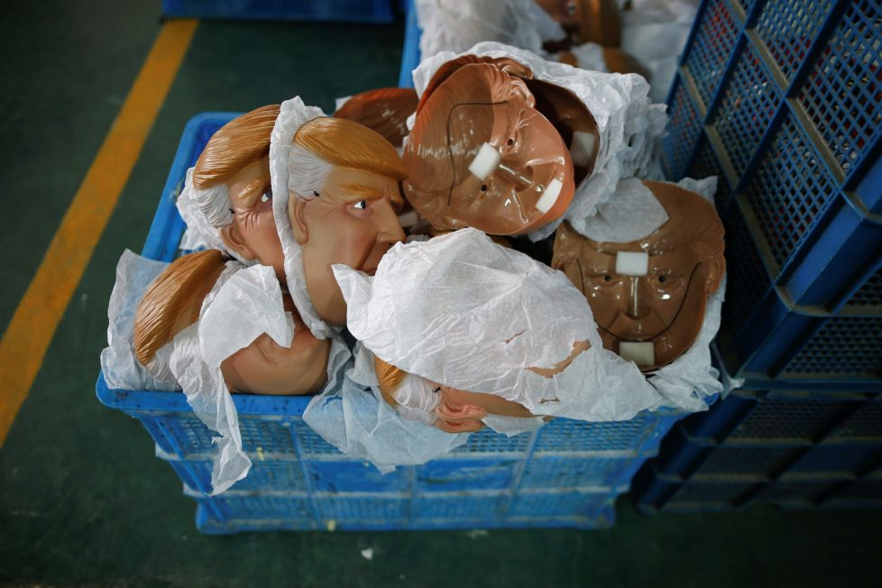 """Masks of U.S. Republican presidential candidate Donald Trump lie in a box at Jinhua Partytime Latex Art and Crafts Factory in Jinhua, Zhejiang Province, China, May 25, 2016. There's no masking the facts. One Chinese factory is expecting Donald Trump to beat his likely U.S. presidential rival Hilary Clinton in the popularity stakes. At the Jinhua Partytime Latex Art and Crafts Factory, a Halloween and party supply business that produces thousands of rubber and plastic masks of everyone from Osama Bin Laden to Spiderman, masks of Donald Trump and Democratic frontrunner Hillary Clinton faces are being churned out. Sales of the two expected presidential candidates are at about half a million each but the factory management believes Trump will eventually run out the winner. """"Even though the sales are more or less the same, I think in 2016 this mask will completely sell out,"""" said factory manager Jacky Chen, indicating a Trump mask. REUTERS/Aly Song SEARCH """"JINHUA MASK"""" FOR THIS STORY. SEARCH """"THE WIDER IMAGE"""" FOR ALL STORIES."""