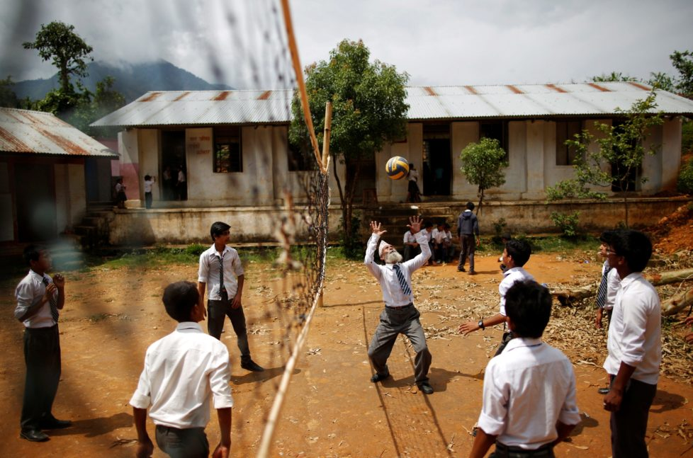 "Durga Kami, 68, who is studying in the tenth grade at Shree Kala Bhairab Higher Secondary School, plays volleyball with friends during a break in Syangja, Nepal, June 5, 2016. REUTERS/Navesh Chitrakar. SEARCH ""DURGA KAMI"" FOR THIS STORY. SEARCH ""THE WIDER IMAGE"" FOR ALL STORIES . TPX IMAGES OF THE DAY"