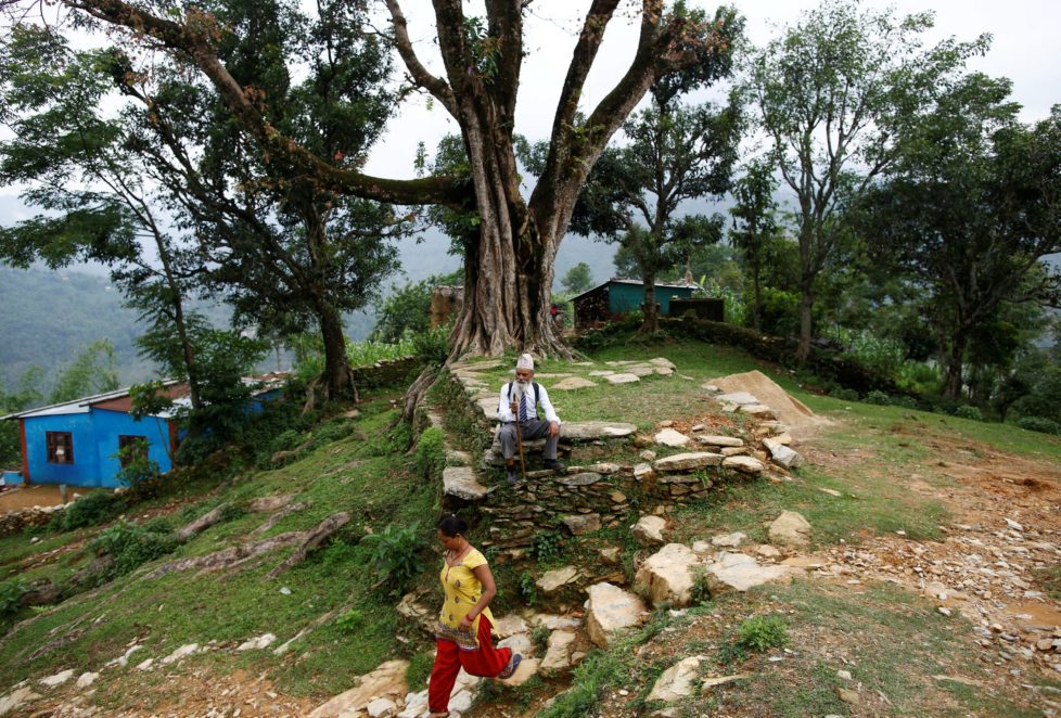 "Durga Kami, 68, who is studying in the tenth grade at Shree Kala Bhairab Higher Secondary School, takes a rest as he walks to school in Syangja, Nepal, June 5, 2016. REUTERS/Navesh Chitrakar. SEARCH ""DURGA KAMI"" FOR THIS STORY. SEARCH ""THE WIDER IMAGE"" FOR ALL STORIES"
