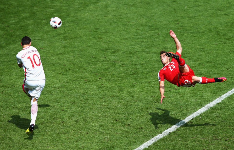SAINT-ETIENNE, FRANCE - JUNE 25: Xherdan Shaqiri of Switzerland scores his team's first goal during the UEFA EURO 2016 round of 16 match between Switzerland and Poland at Stade Geoffroy-Guichard on June 25, 2016 in Saint-Etienne, France. (Photo by Alex Livesey/Getty Images)