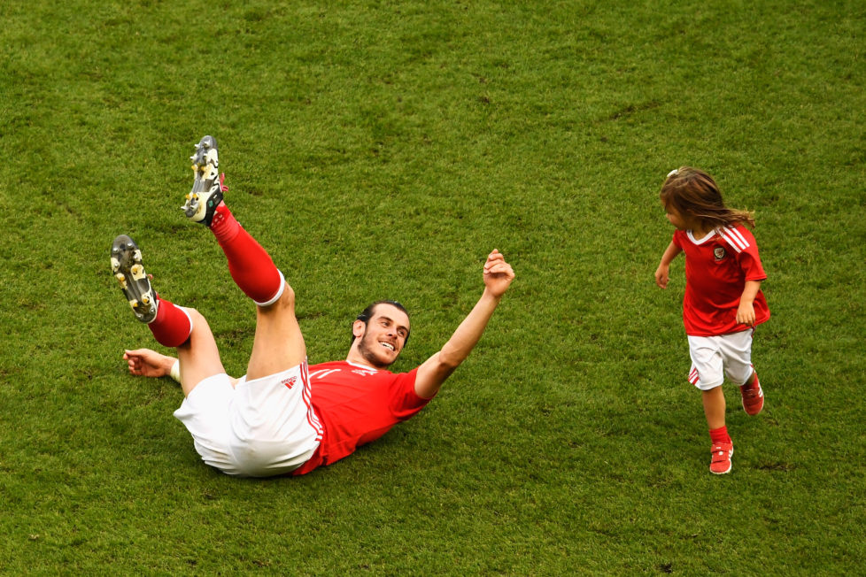 PARIS, FRANCE - JUNE 25: Gareth Bale of Wales celebrates his team's win with his daughter Alba Violet after the UEFA EURO 2016 round of 16 match between Wales and Northern Ireland at Parc des Princes on June 25, 2016 in Paris, France. (Photo by Mike Hewitt/Getty Images)