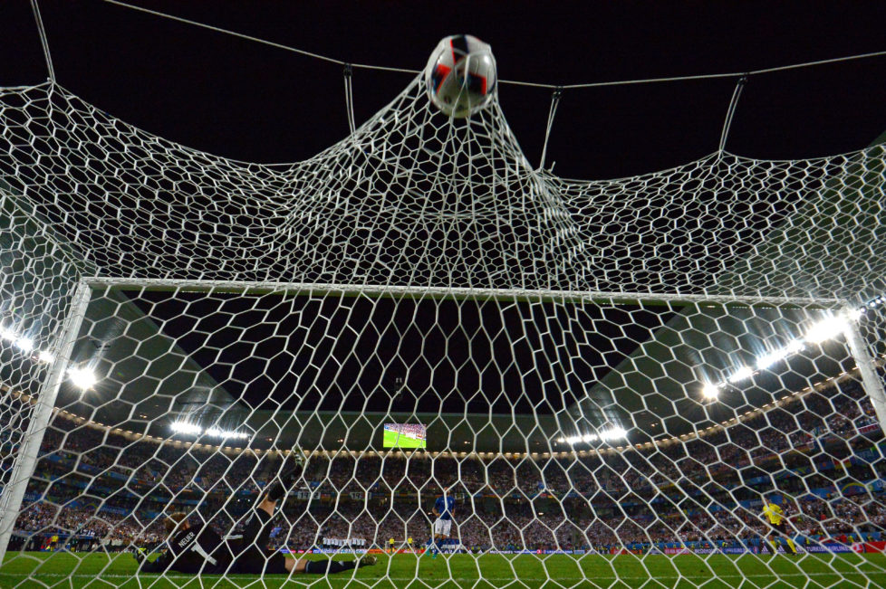 Germany's goalkeeper Manuel Neuer misses the ball by Italy's defender Andrea Barzagli during a spot-kick in the penalty shoot-out in the Euro 2016 quarter-final football match between Germany and Italy at the Matmut Atlantique stadium in Bordeaux on July 2, 2016. / AFP PHOTO / VINCENZO PINTO
