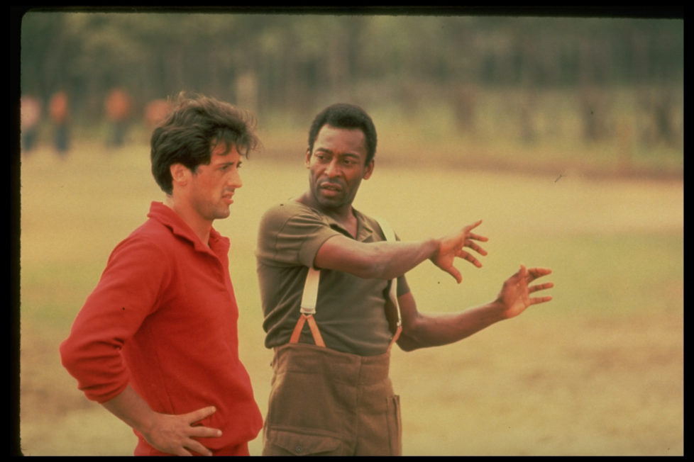 (L-R) Actor Sylvester Stallone getting pointers fr. soccer great Pele during filming of motion picture Escape to Victory. (Photo by John Bryson/The LIFE Images Collection/Getty Images)