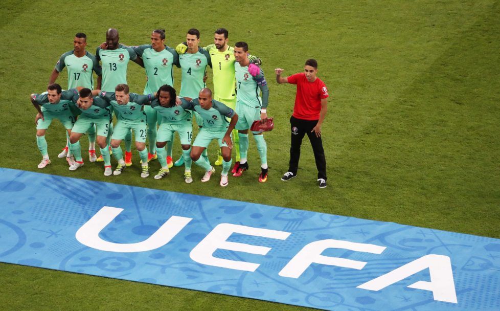 epa05411360 A young man poses next to the Portuguese team prior to the UEFA EURO 2016 semi final match between Portugal and Wales at Stade de Lyon in Lyon, France, 06 July 2016. (RESTRICTIONS APPLY: For editorial news reporting purposes only. Not used for commercial or marketing purposes without prior written approval of UEFA. Images must appear as still images and must not emulate match action video footage. Photographs published in online publications (whether via the Internet or otherwise) shall have an interval of at least 20 seconds between the posting.) EPA/SRDJAN SUKI EDITORIAL USE ONLY