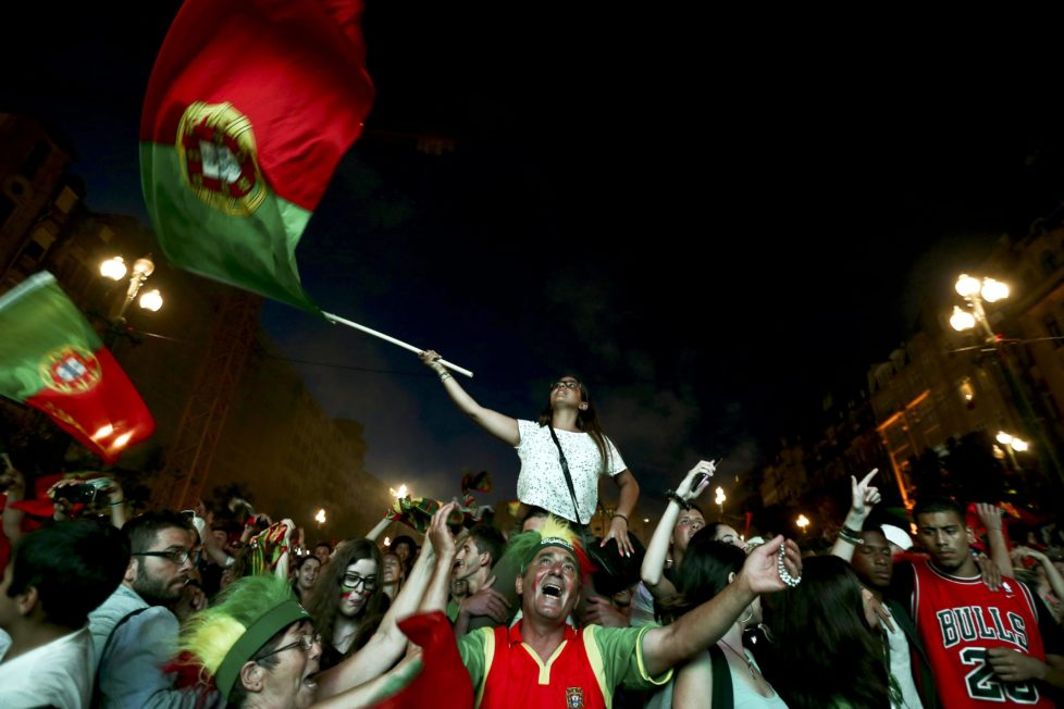 epa05411924 Supporters of Portugal celebrate during the public viewing of the UEFA EURO 2016 semi final match between Portugal vs Wales at Avenida dos Aliados, in Porto, Portugal, 06 July 2016. EPA/ESTELA SILVA