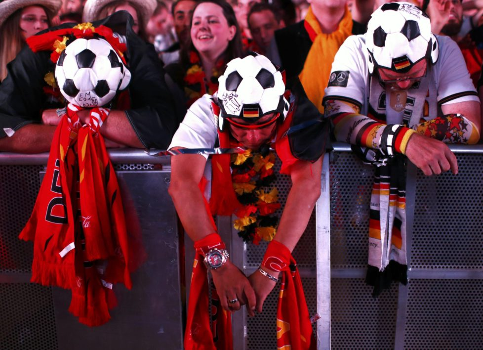 Fans of Germany react as they watch the Euro 2016 match between France and Germany in France at a public screening of the match in Berlin, Germany, July 7, 2016. REUTERS/Hannibal Hanschke