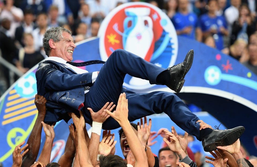 PARIS, FRANCE - JULY 10: Fernando Santos manager of Portugal is thrown into the air by his players after his side win 1-0 against France during the UEFA EURO 2016 Final match between Portugal and France at Stade de France on July 10, 2016 in Paris, France. (Photo by Laurence Griffiths/Getty Images) *** BESTPIX ***