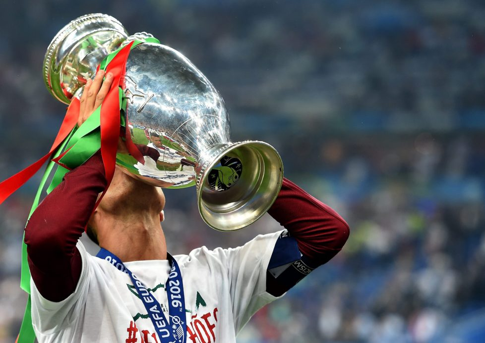 epa05419789 Cristiano Ronaldo of Portugal kisses the trophy after winning the UEFA EURO 2016 Final match against France at Stade de France in Saint-Denis, France, 10 July 2016. (RESTRICTIONS APPLY: For editorial news reporting purposes only. Not used for commercial or marketing purposes without prior written approval of UEFA. Images must appear as still images and must not emulate match action video footage. Photographs published in online publications (whether via the Internet or otherwise) shall have an interval of at least 20 seconds between the posting.) EPA/ETIENNE LAURENT EDITORIAL USE ONLY