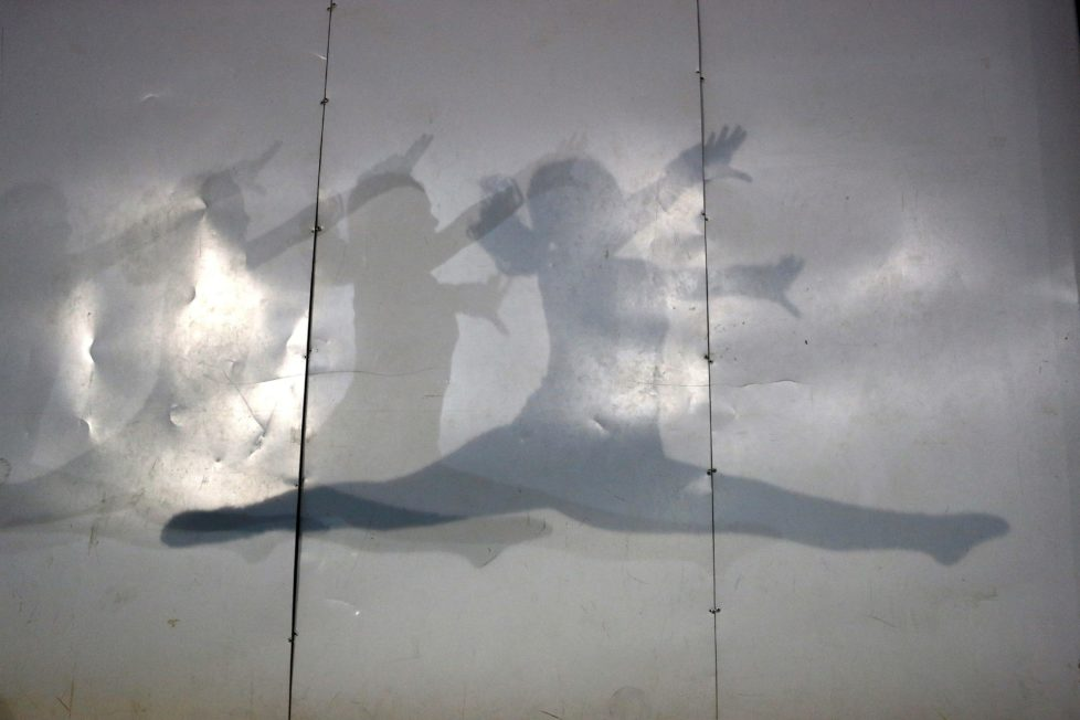 Shadows of a gymnast are cast on a wall during a training session at the school-gym of Tomas Gonzalez, the first Chilean gymnast to qualify twice for the Olympics, in Santiago, Chile July 20, 2016. Picture taken July 20, 2016. REUTERS/Ivan Alvarado