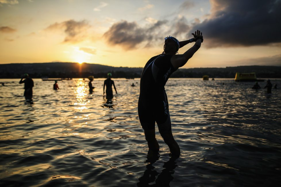 ZURICH, SWITZERLAND - JULY 24: (EDITORS NOTE - digital filters were used in the creation of this image) Athlets prepare for the swim leg before Ironman Zurich on July 24, 2016 in Zurich, Switzerland. (Photo by Joern Pollex/Getty Images)