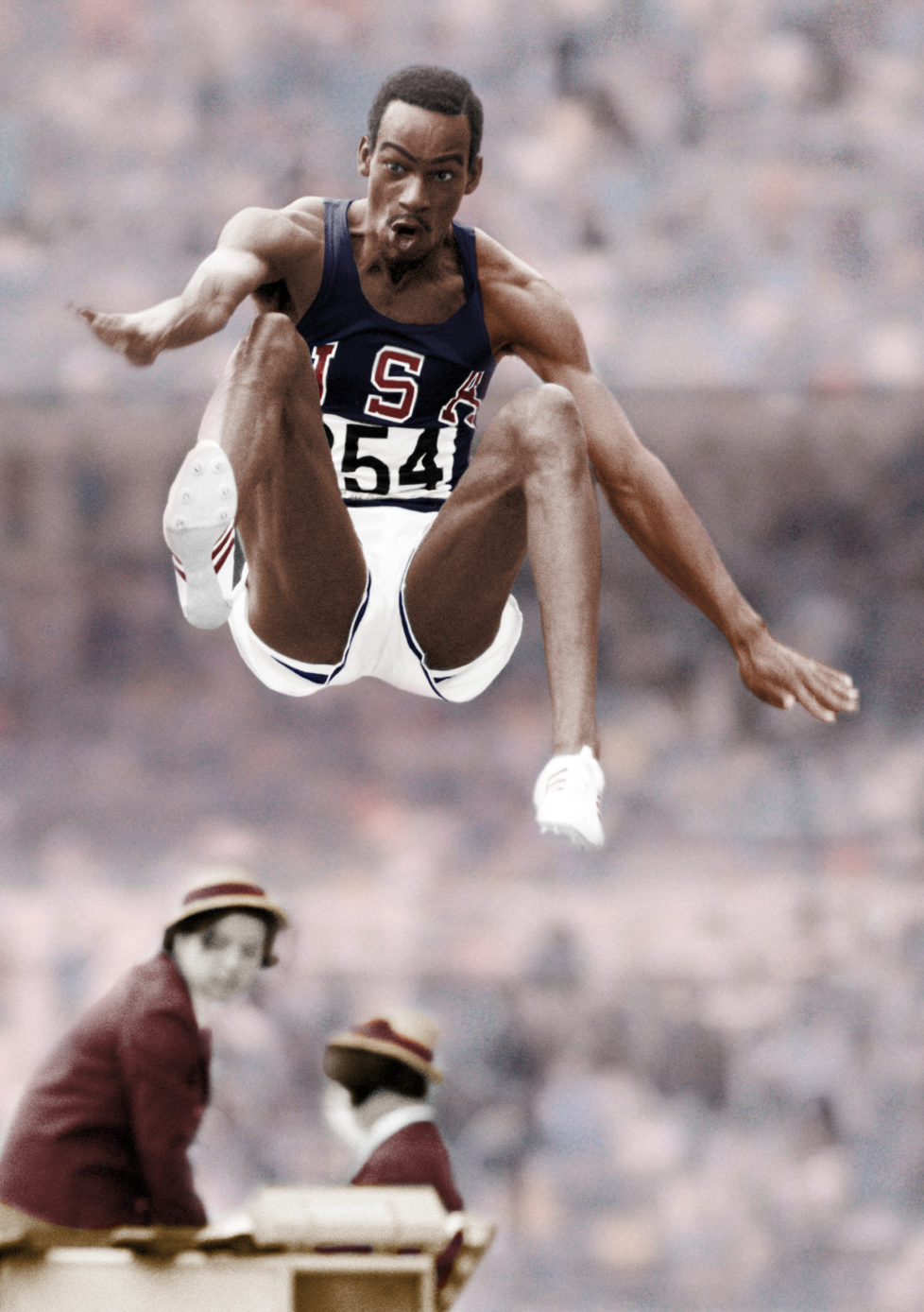 NOTE TO EDITORS; THIS ORIGINAL BLACK & WHITE IMAGE HAS BEEN DIGITALLY PROCESSED. Bob Beamon of the United States setting a new world record of 8.90 metres for the long jump during the Summer Olympic Games in Mexico City 18th October 1968. (Photo by Ed Lacey/Popperfoto/Getty Images)