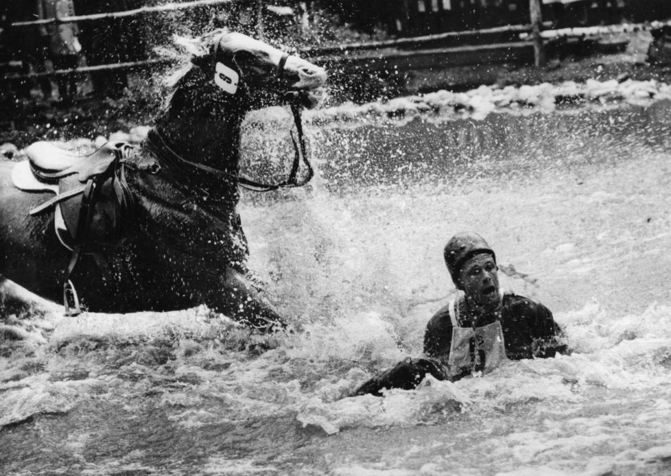 Finnish rider R A Kuistila in the water after falling from his horse during the Equestrian Olympic Games in Stockholm. (Photo by Keystone/Getty Images)