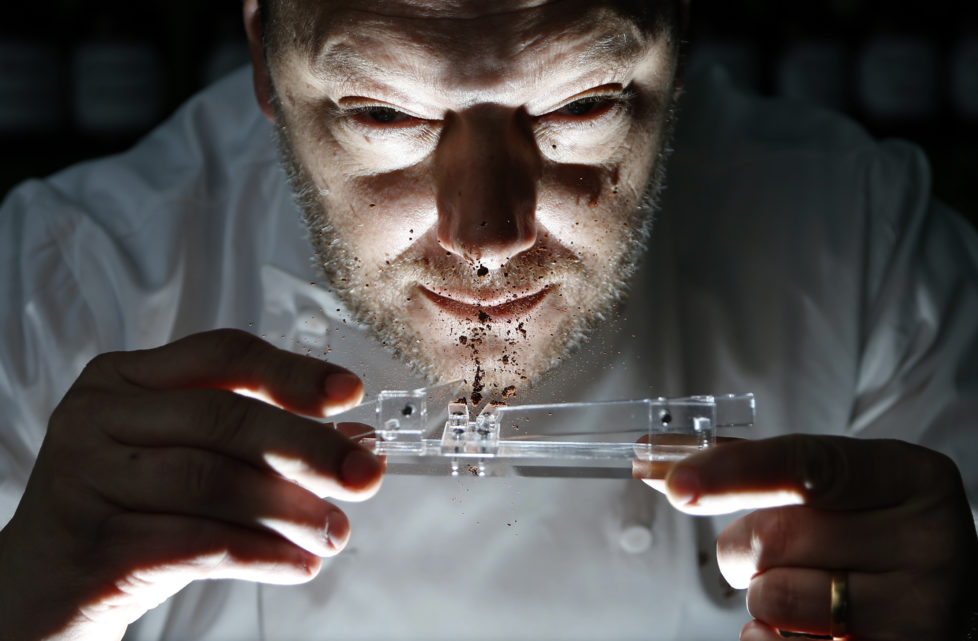 Belgian chocolatier Dominique Persoone snorts cocoa powder off his Chocolate Shooter in his factory in Bruges, February 3, 2015. When Belgian chocolatier Dominique Persoone created a chocolate-sniffing device for a Rolling Stones party in 2007, he never imagined demand would stretch much beyond the rock 'n' roll scene. But, seven years later, he has sold 25,000 of them. Inspired by a device his grandfather used to propel tobacco snuff up his nose, Persoone created a 'Chocolate Shooter' to deliver a hit of Dominican Republic or Peruvian cocoa powder, mixed with mint and either ginger or raspberry. Picture taken on February 3, 2015. REUTERS/Francois Lenoir (BELGIUM - Tags: FOOD SOCIETY TPX IMAGES OF THE DAY) - RTR4OIHA