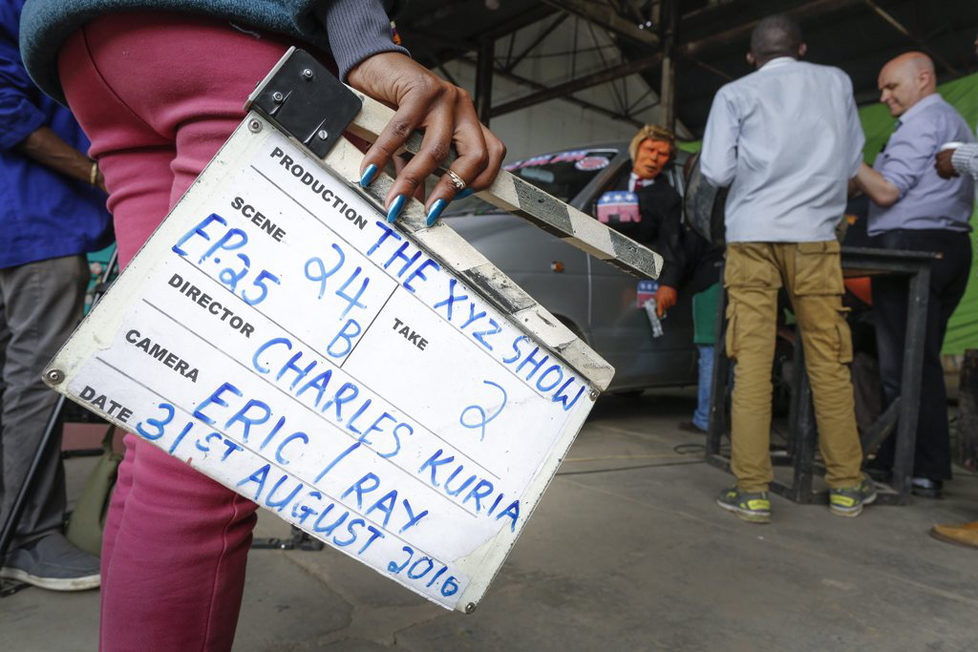 epa05548721 (03/19) A prodution assistant holds a clapperboard as she watches the shooting of the 11th season of 'The XYZ Show' satirical puppet show featuring the Donald Trump puppet at a studio in Nairobi, Kenya, 31 August 2016. The XYZ Show is Kenya's popular satirical television program and has been taking pokes at the country's political elites and international figures ever since it aired its first episode in 2009. With the 2016 US presidential elections, the show is now taking on Republican Presidential candidate Donald Trump. EPA/DAI KUROKAWA PLEASE REFER TO ADVISORY NOTICE (epa05548718) FOR FULL FEATURE TEXT