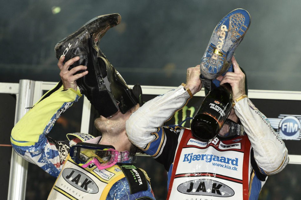 epa05554873 2nd placed Chris Holder (L) and winner Jason Doyle celebrate on the podium after the final heat during the FIM Speedway World Championship at Friends Arena in Stockholm, Sweden, 24 September 2016. EPA/Claudio Bresciani