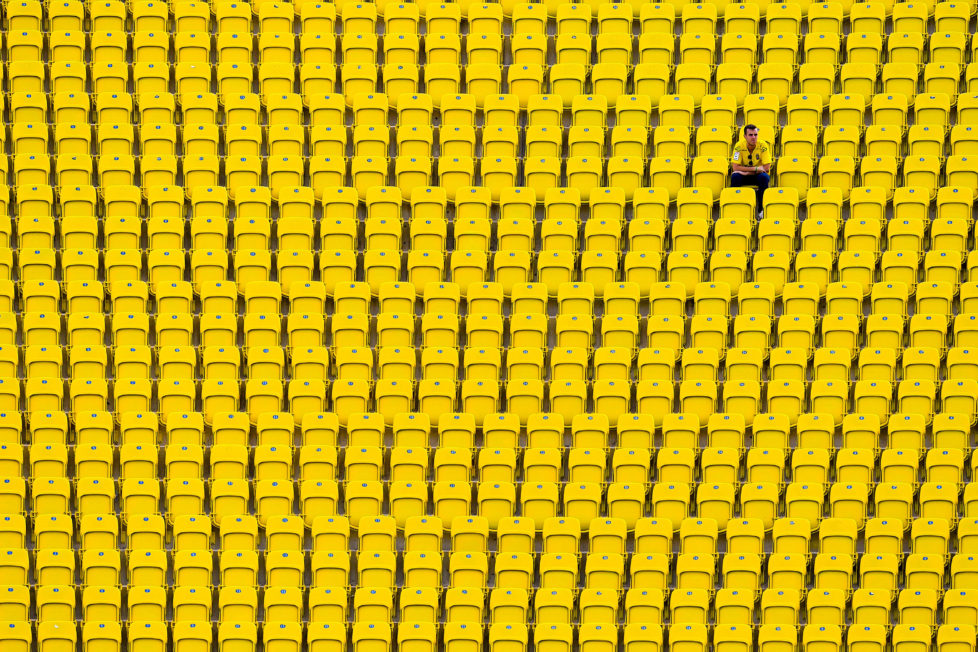 LAS PALMAS, SPAIN - SEPTEMBER 24: A UD Las Palmas supporter sits on the stand prior to the La Liga match between UD Las Palmas and Real Madrid CF on September 24, 2016 in Las Palmas, Spain. (Photo by David Ramos/Getty Images)