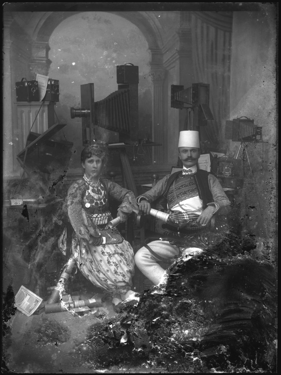 Kel Marubi with his wife in the studio, no date, silver gelatine dry process on glass © Kel Marubi / Marubi National Museum of Photography, Shkodër