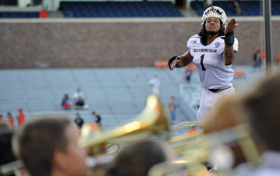 Western Michigan defensive end Keion Adams (1) pretends to conduct the Western Michigan Marching Band after defeating Illinois in an NCAA college football game Saturday, Sept. 17, 2016, at Memorial Stadium in Champaign, Ill. (AP Photo/Bradley Leeb)