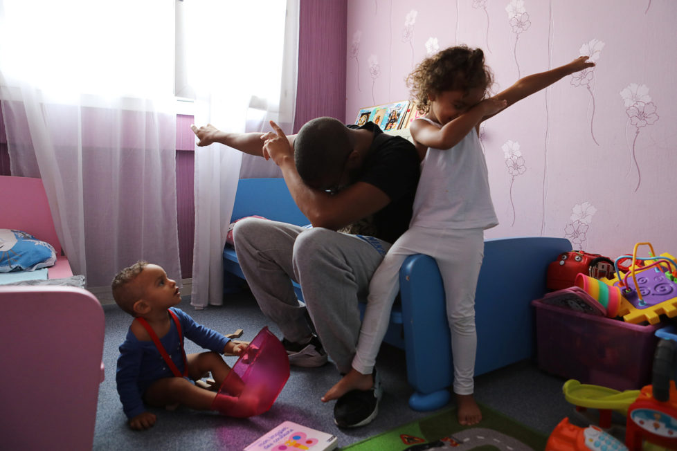 """Rapper Worms-T plays with his children in Pantin, France, September 2, 2016. REUTERS/Joe Penney SEARCH """"CREATIVE BANLIEUE"""" FOR THIS STORY. SEARCH """"WIDER IMAGE"""" FOR ALL STORIES.? THE IMAGES SHOULD ONLY BE USED TOGETHER WITH THE STORY - NO STAND-ALONE USES."""