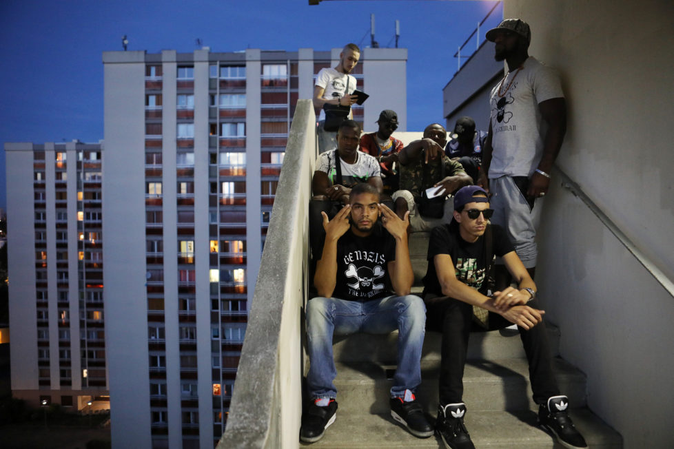 """Rapper Worms-T poses for a picture with friends from the """"La Rue La Vraie"""" (The Real Street) crew on a staircase in the Cite Raymond Queneau in Pantin, France, September 1, 2016. REUTERS/Joe Penney SEARCH """"CREATIVE BANLIEUE"""" FOR THIS STORY. SEARCH """"WIDER IMAGE"""" FOR ALL STORIES. TPX IMAGES OF THE DAY?THE IMAGES SHOULD ONLY BE USED TOGETHER WITH THE STORY - NO STAND-ALONE USES."""