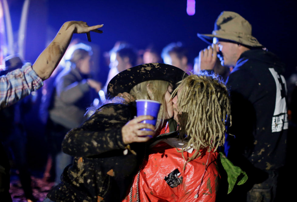 """A couple kiss on the final night of the Deni Ute Muster in Deniliquin, New South Wales, Australia, October 1, 2016. REUTERS/Jason Reed SEARCH """"UTE CULTURE"""" FOR THIS STORY. SEARCH """"THE WIDER IMAGE"""" FOR ALL STORIES."""