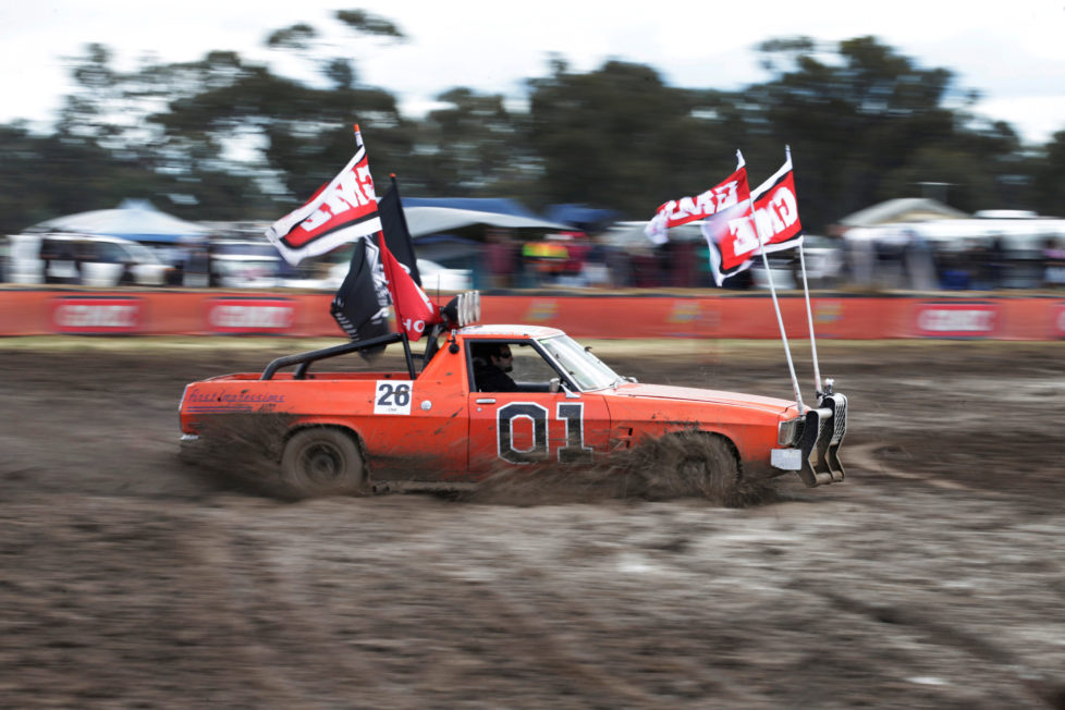 "Robert Dowse, 35, from Frankston in the Australian state of Victoria powers his Australian 'ute' he calls ""General Lee"" through thick mud during a 'circle work' competition of vehicle handling skills at the Deni Ute Muster in Deniliquin, New South Wales, September 30, 2016. REUTERS/Jason Reed SEARCH ""UTE CULTURE"" FOR THIS STORY. SEARCH ""THE WIDER IMAGE"" FOR ALL STORIES."