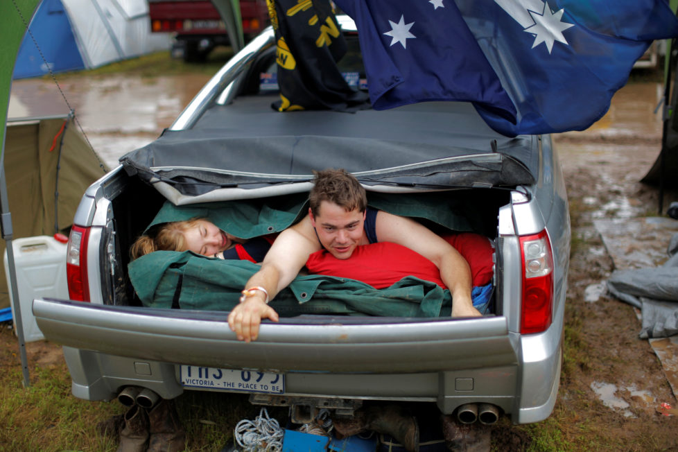 "Australian couple Darren McGarvie, 27, and Nicole York, 24, wake up after spending the night together in McGarvie's Holden Commodore Ute at the Deni Ute Muster in Deniliquin, New South Wales, Australia, October 1, 2016. REUTERS/Jason Reed SEARCH ""UTE CULTURE"" FOR THIS STORY. SEARCH ""THE WIDER IMAGE"" FOR ALL STORIES."