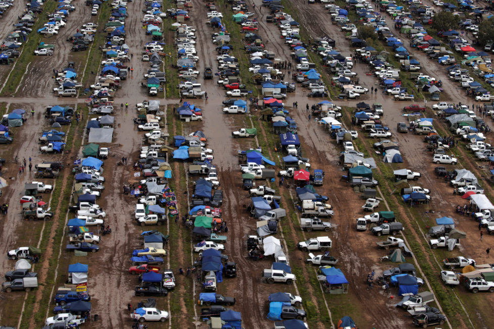"Campers trudge through mud among hundreds of ute vehicles in a paddock in this aerial picture at the Deni Ute Muster in Deniliquin, New South Wales, Australia, October 1, 2016. REUTERS/Jason Reed SEARCH ""UTE CULTURE"" FOR THIS STORY. SEARCH ""THE WIDER IMAGE"" FOR ALL STORIES."