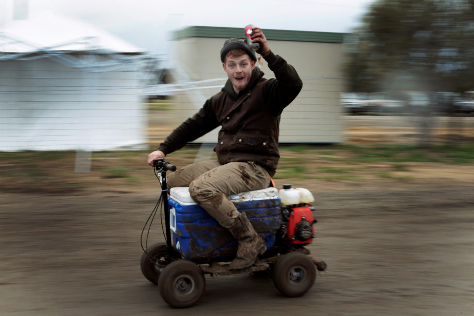 "Sheep shearer Chris Kermond from Ballarat in the Australian state of Victoria rides a motorised 'esky' or drink cooler, while drinking a can of pre-mixed rum and cola at the Deni Ute Muster in Deniliquin, New South Wales, September 29, 2016. REUTERS/Jason Reed SEARCH ""UTE CULTURE"" FOR THIS STORY. SEARCH ""THE WIDER IMAGE"" FOR ALL STORIES."