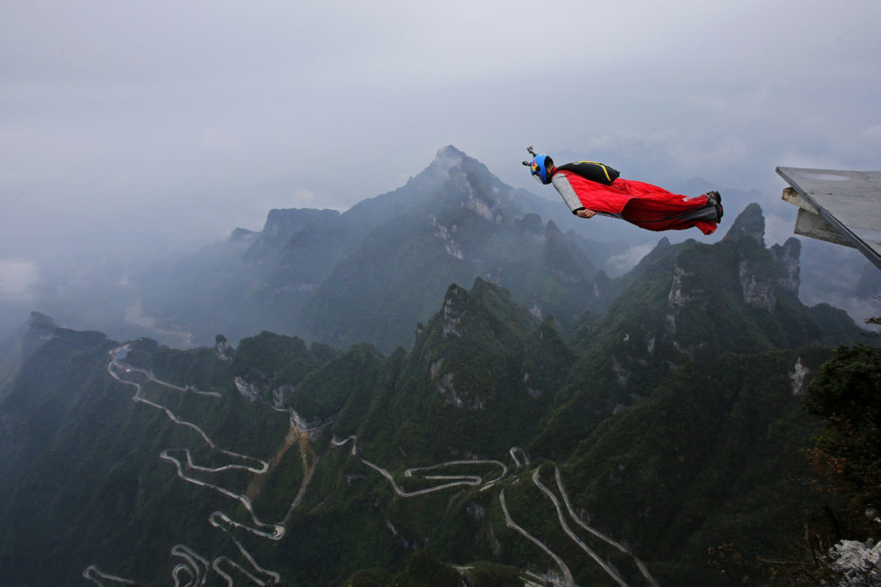 ZHANGJIAJIE, CHINA - OCTOBER 13: Wingsuit flyer Gabriel Lott of Brazil jumps off a mountain during the 5th World Wingsuit Championship at Tianmen Mountain on October 13, 2016 near Zhangjiajie, Hunan province, China. A total of 16 participants from around the world took part in the extreme sport which involves jumping down cliffs at an altitude of 1,400 km (4,593,180 ft) while wearing a wingsuit. (Photo by Wang He/Getty Images)