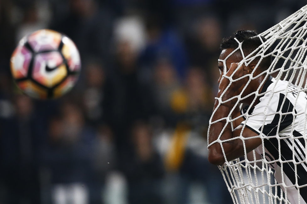 Juventus' defender Alex Sandro from Brazil reacts during the Italian Serie A football match Juventus vs Udinese on October 15, 2016 at the 'Juventus Stadium' in Turin. / AFP PHOTO / MARCO BERTORELLO